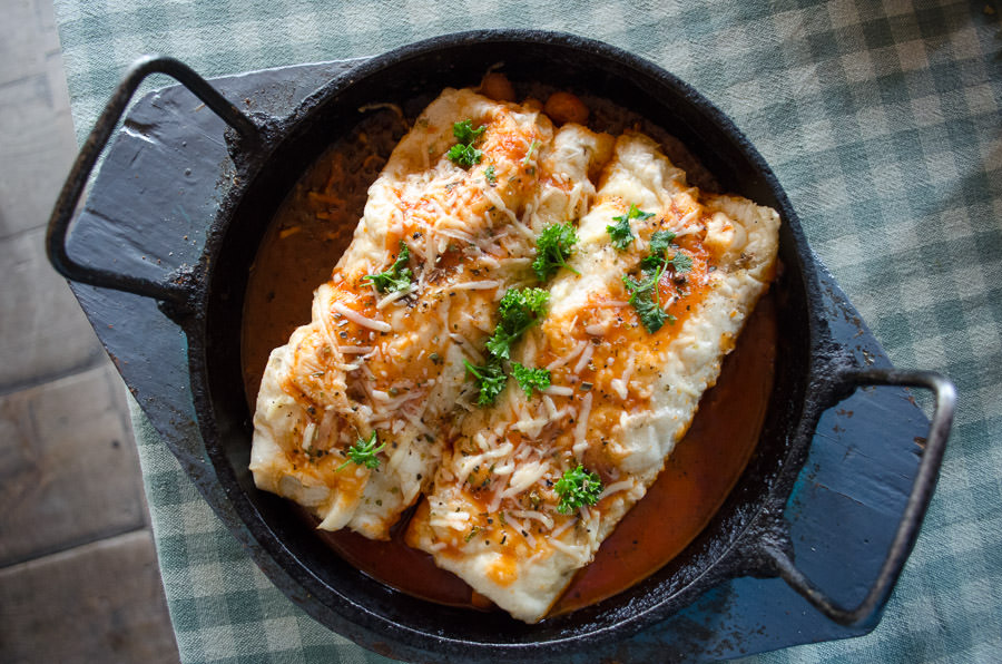 A skillet of enchiladas in Muktinath, Nepal