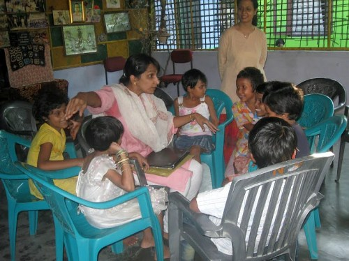 Meena (in the centre) telling the story to 20 kids at NabPrabhat Orphanage at Tezpur, Assam