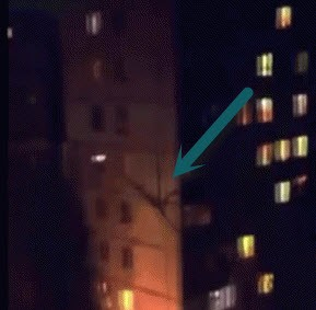 Stick Like Alien Creature Climbing Building in Russia