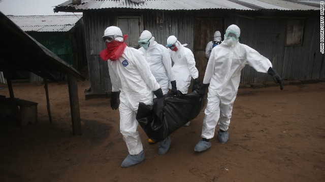 MONROVIA, LIBERIA - AUGUST 17:  A Liberian burial team wearing protective clothing retrieves the body of a 60-year-old Ebola victim from his home on August 17, 2014 near Monrovia, Liberia. The epidemic has killed more than 1,000 people in four African countries, and Liberia now has had more deaths than any other country.  (Photo by John Moore/Getty Images)
