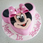 3D Minnie Mouse birthday cake with pink icing bow and polka dots