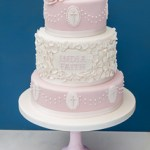 3 tier Christening cake. Pink and white with petal and dot decoration.