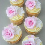 Delicate pink roses on butter-cream