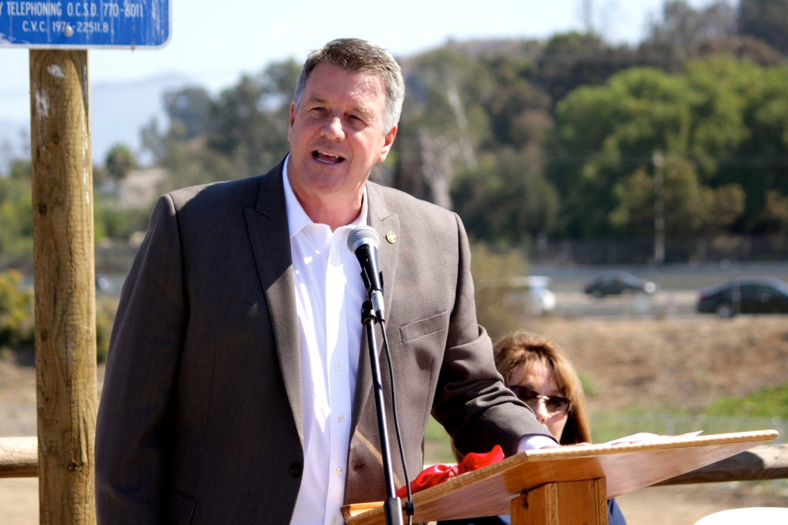 San Juan Capistrano Mayor John Taylor delivers a speech during the grand opening of the Dr. Joe Cortese Dog Park. Photo by Brian Park