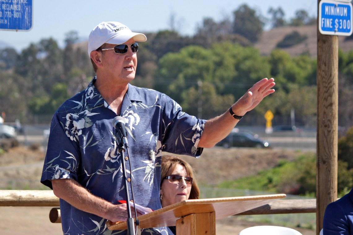 Dick Paulsen, vice president of the Open Space Foundation, thanks the city and the foundation's volunteers for helping build the Dr. Joe Cortese Dog Park. Photo by Brian Park