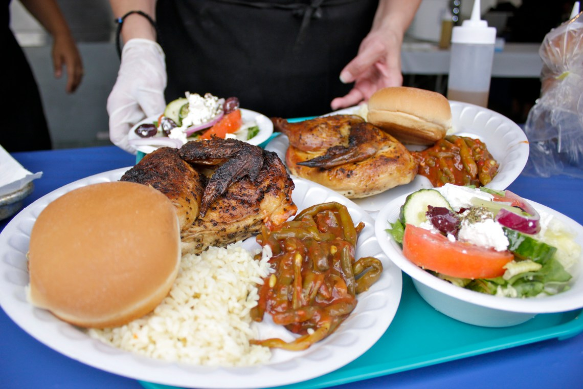 Festivalgoers had their take of authentic Greek cuisine, including a meal of oregano chicken with greek beans, rice and salad. Photo by Brian Park