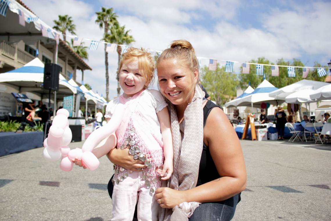 Bailey Bailey and her daughter Hunter stop for photo during the Greek Festival. Photo by Brian Park