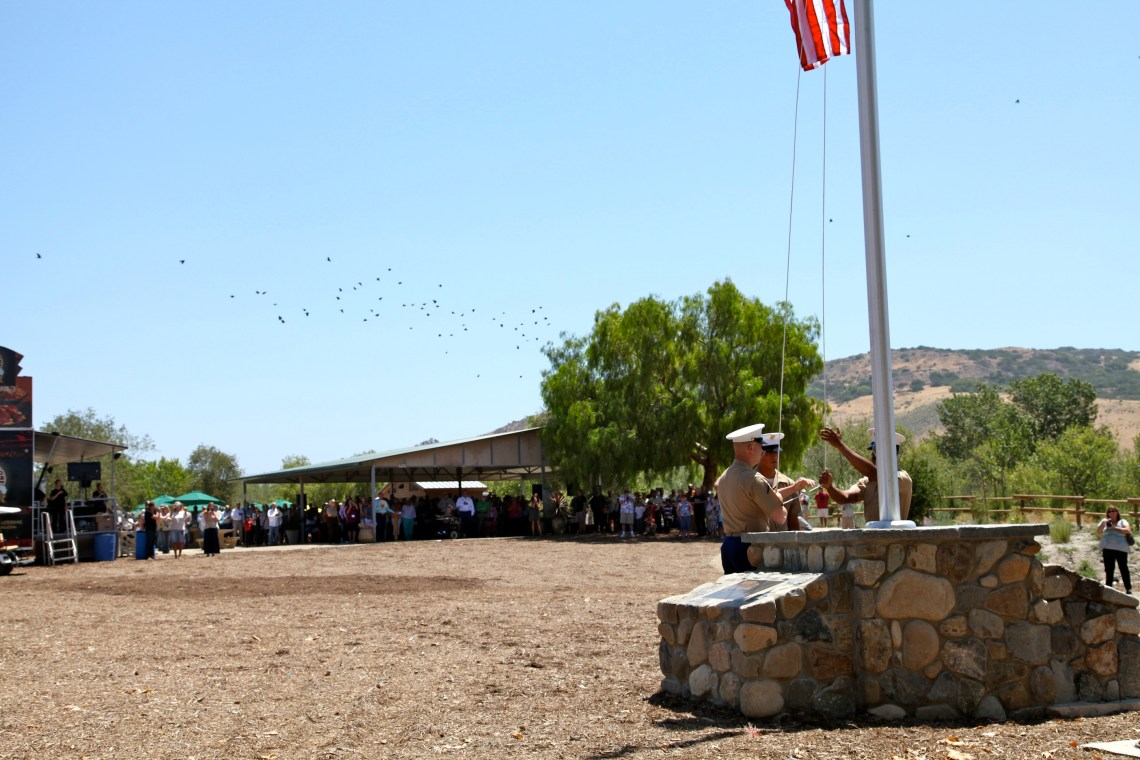 The 1st Battalion, 11th Marines raised the flag at the Reata Park and Event Center. Photo by Brian Park