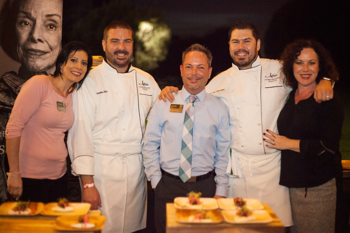 (Left to Right) From Atria San Juan, Jennifer Frost, life guidance director; Andrew Schwartz; Justin Ashton, business director; Chef George; and Kim Moore, sales director, served up Asian tacos on sticky buns with brown butter soy short rib and watermelon daikon slaw. Photo: Alex Paris