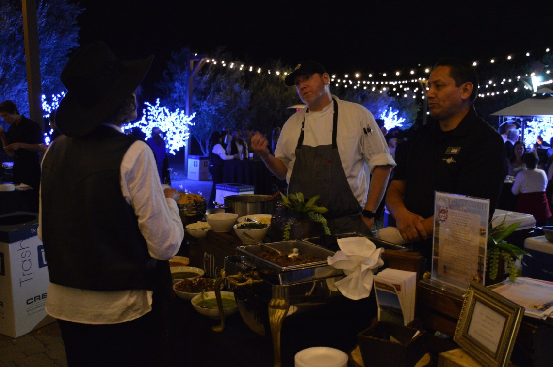 O'Neill's Bar & Grill serves up tacos de lengua to an attendee at The Taste of San Juan. Photo: Emily Rasmussen