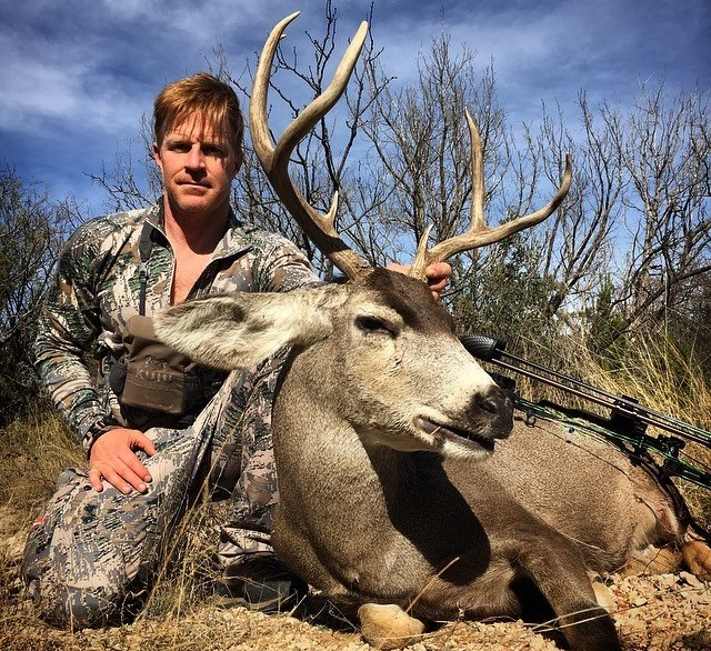 Erskine poses with a sizeable animal of the elk family. Photo: Courtesy.