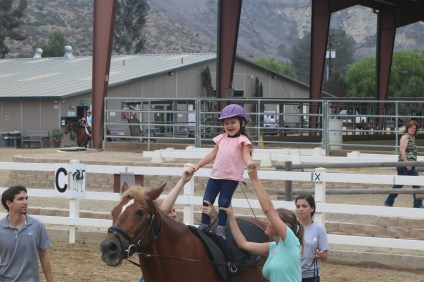 Ava Mauerhan, 3, is all smiles as she stands on a horse at the Shea Center on Saturday, Sept. 1. Photo: Alex Groves.