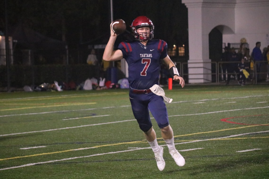 Quarterback James Mott attempts a pass during St. Margaret's Military Appreciation Night game against Bishop Diego. Photo: Zach Cavanagh