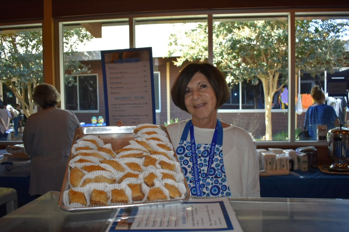 Angie Couples shows off Baklava at the annual San Juan Capistrano Greek Festival on Saturday, Sept. 29. Photo: Alex Groves