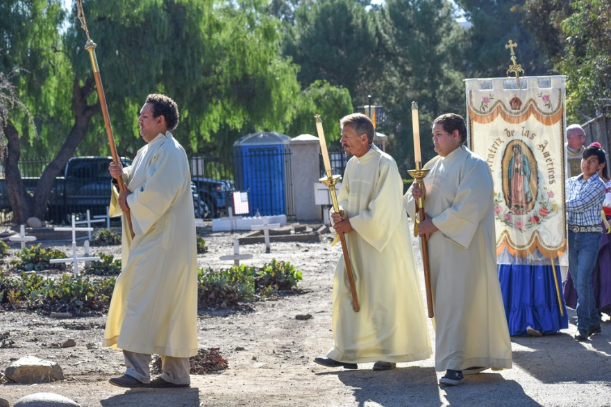 A procession makes its way into the Old Mission Cemetery in San Juan Capistrano for the 9th Annual Mass of Remembrance on Saturday, Nov. 10. Photo: Alex Groves