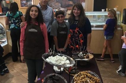 Randa Basily (right) recently opened a Rocky Mountain Chocolate