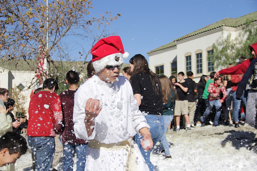 A snowball explodes on impact in front of Father Damien Giap. Photo: Shawn Raymundo