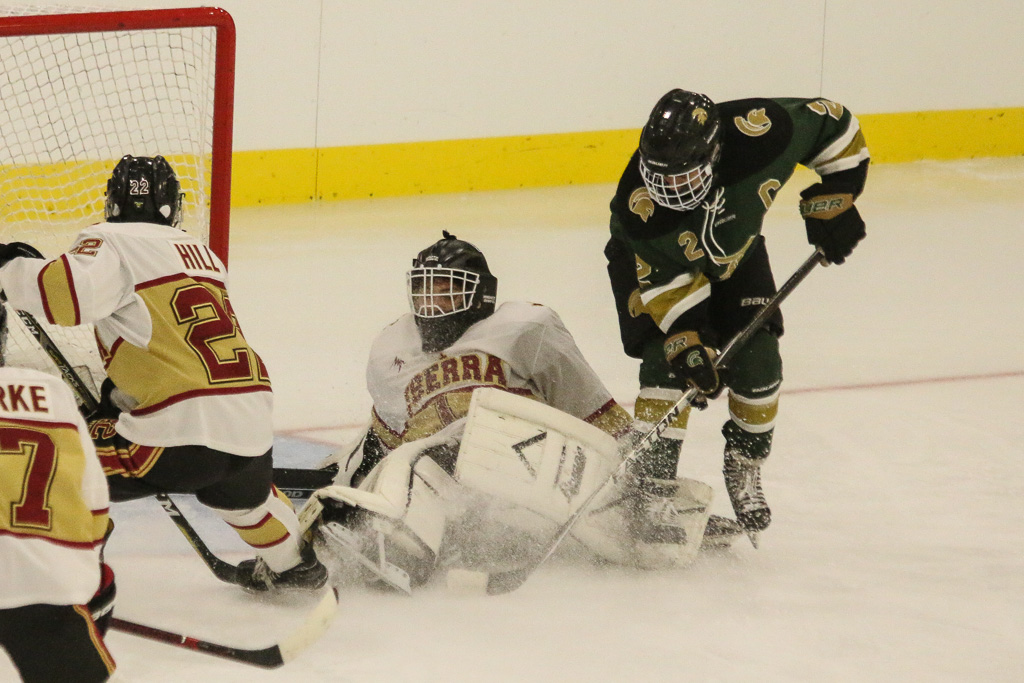 JSerra goalie John Ferletic covers the puck in the third period against Damien on Friday, Feb. 8. Photo: Eric Heinz
