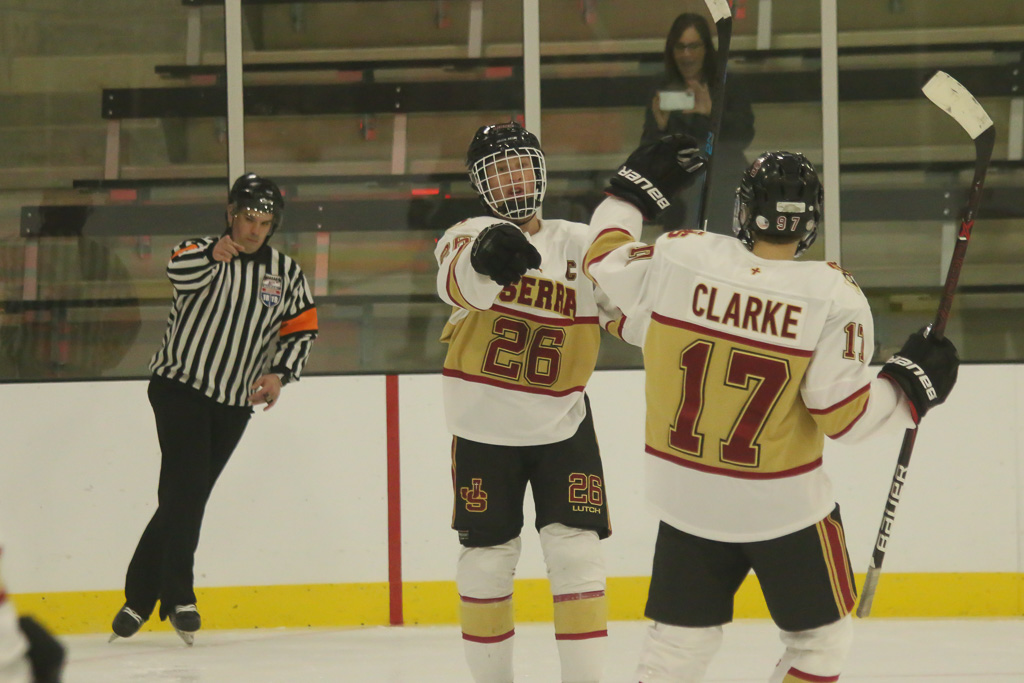 Blake Reed gives some credit to Conor Clarke after his third goal to put the Lions up 5-1 on Feb. 8. Photo: Eric Heinz
