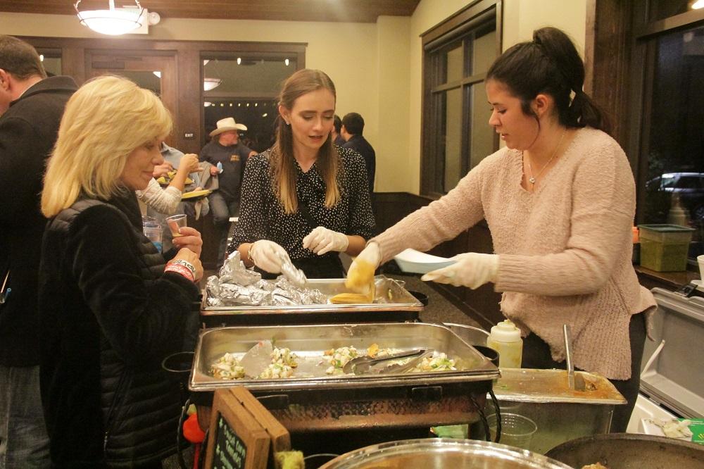 Paola Izquierdo and Katie Harland of El Adobe de Capistrano serve a sampling of tamales to Dana Point resident Maria Elana Banks during the Taste of San Juan on Thursday, Jan. 31. Photo: Shawn Raymundo