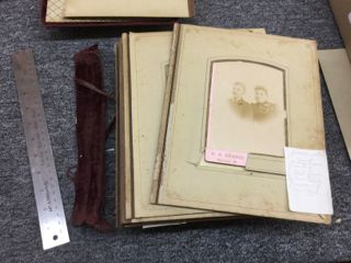 Inside, the still board pages were mostly separated, as the cloth hinges had torn with use.