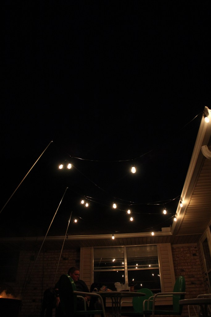 Add ambiance to your outdoor space by hanging the perfect outdoor lighting! This fool-proof method of hanging string lights is perfect for any patio or evening party!