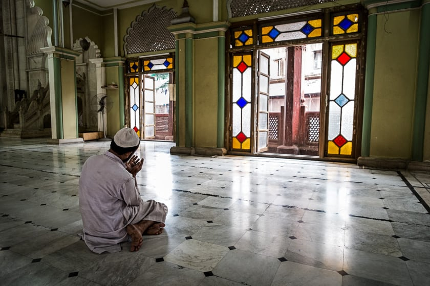 """After Nimaaz (or formal prayers) people will often stay and perform """"dua"""" or prayers of petition or supplication, as this man does."""