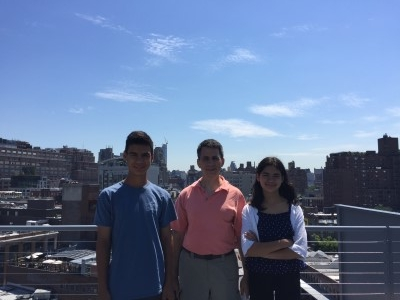 Jacob, David, and Isabella with New York skyline.
