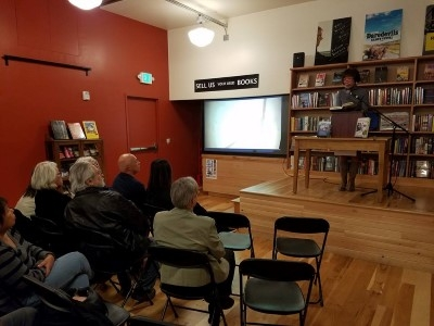 Reading at the stage of Third Place Books (photo courtesy of Peter Vershoor).