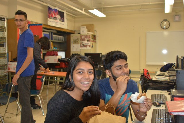 Seniors, Syeda Ahmed and Shiv Lal trying Levain Bakery's signature chocolate chip walnut cookie!