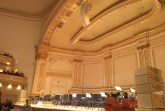 Carnegie Hall's stage is filled with seats and open music scores, awaiting to be filled with musicians to fill the theater with melodies.  Photo Credit: Marilyn Ramos
