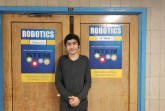 Caption: Jonathan Ustaev,  standing in front of his favorite class; Robotics Photo Credit: Rickcarl Paningsoro