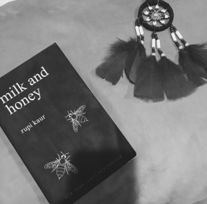 Two of my favorite items, a poetry book to relax my mind and having a dream catcher over hanging over me. Photo Credits: Kelliana Seeraj