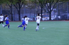 Caption: Edison's girls soccer team playing in a final match. Credit: Esdras Louis
