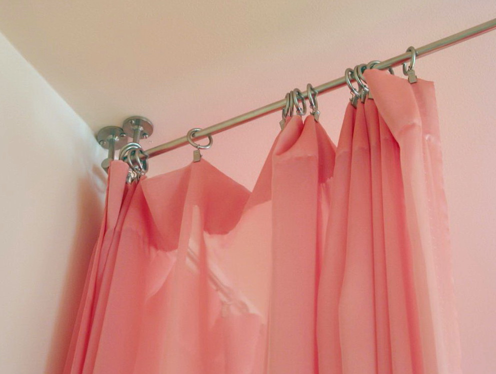 Bed With Curtains Hanging From Ceiling