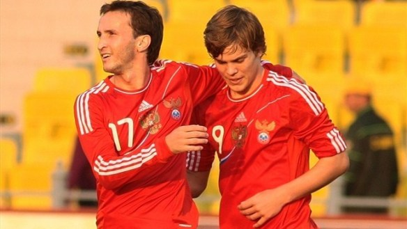 The next Russian star: Dynamo Moscow's young striker, Aleksandr Kokorin congratulated for scoring in a Russia shirt