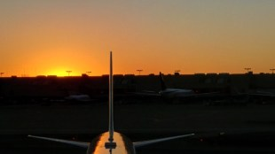 Sun setting over Delta plane at the ATL Skyclub
