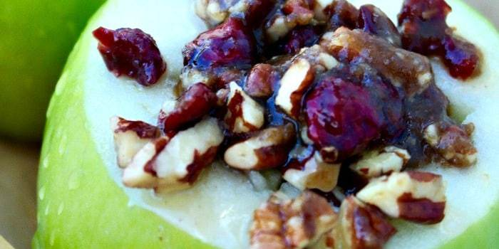 These stuffed baked apples are filled with chopped pecans, cranberries, brown sugar and butter! This easy dessert is a scrumptious dessert for two! The Foodie Affair