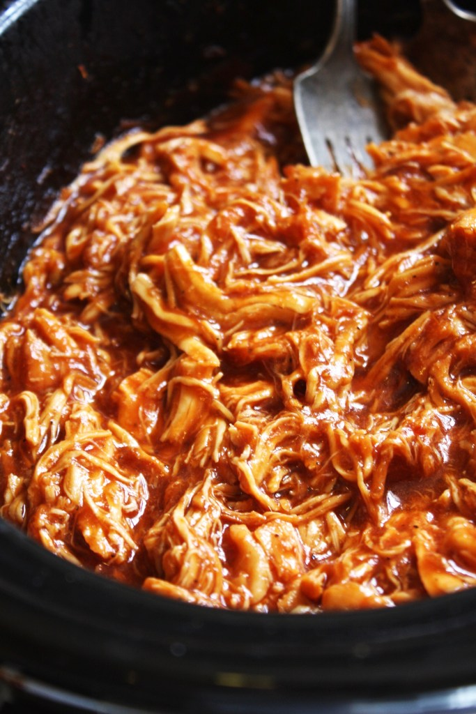 This easy Crock Pot Buffalo Chicken recipe packs a punch of flavor with none of the work. Perfect over rice, on sandwiches, in dips, the versatility will keep you coming back for more.