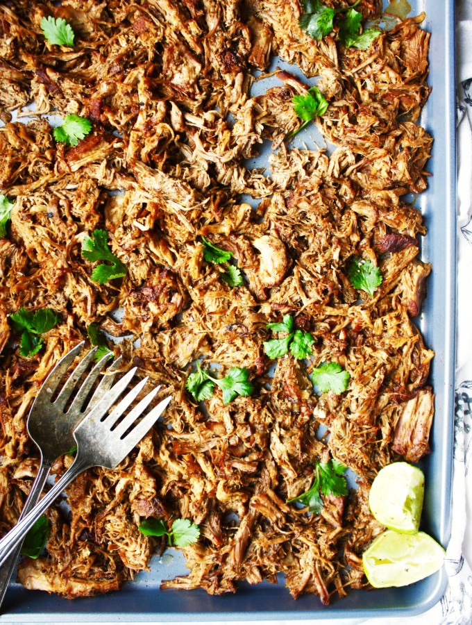 Crispy Slow Roasted Carnitas - This easy meal takes minutes to prep, and the end result is out-of-this-world good! It will be a family favorite in your house, AND the leftovers get better as they sit in the fridge! - TheGarlicDiaries.com