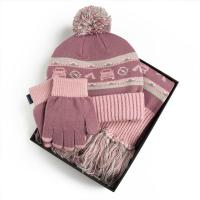 This childrens purple hat, scarf and gloves set is ...