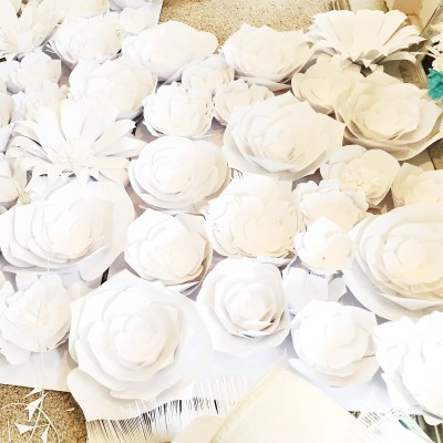 paper flowers, white wedding back drop, giant paper flowers, how to make paper flowers out of card stock. DIY, giant flowers,