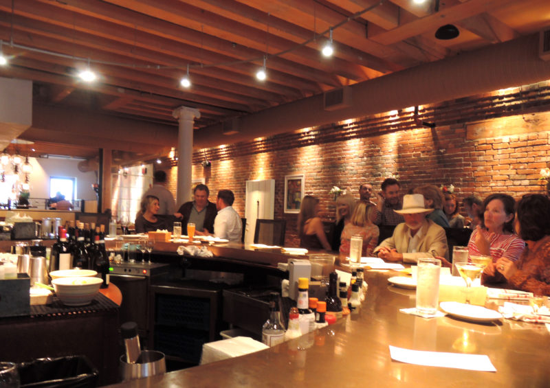 The semi-circular bar has great style and a perfect setting for drinks and/or dinner