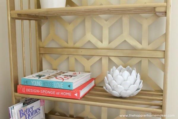 close up geometric gilded bookcase