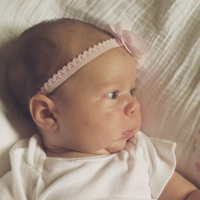 the hess station one month baby photo bouncer with headband profile