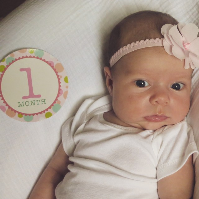 the hess station one month baby photo bouncer with headband