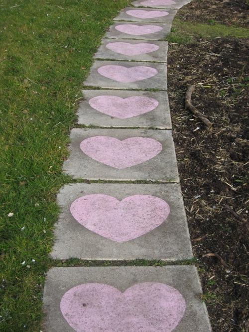 Create a path of love with sidewalk chalk hearts