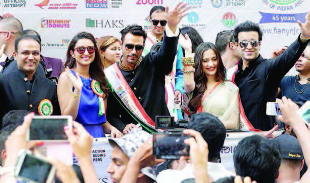 Cricketer Virender Sewhag , Bollywood actor Parineeti Chpra and Grand Marshal Bollywood actor Arjun Rampal greet the crowds at India Day Parade in New York City, August 16