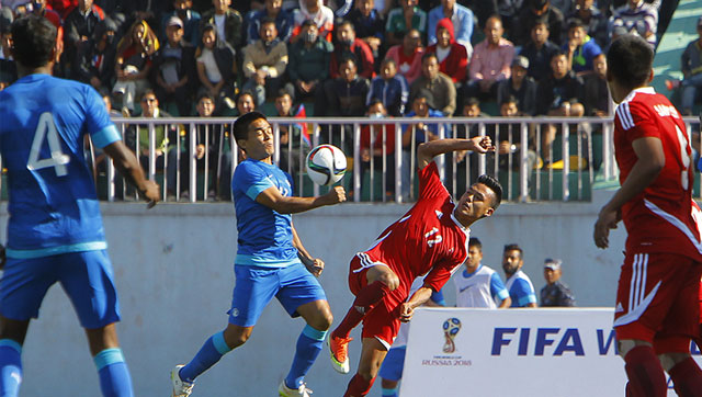 India's Sunil Chhetri competes for the ball with Nepal's Bikram Lama during their 2018 Fifa World Cup qualifying match in Kathmandu, Nepal. (AP Photo)