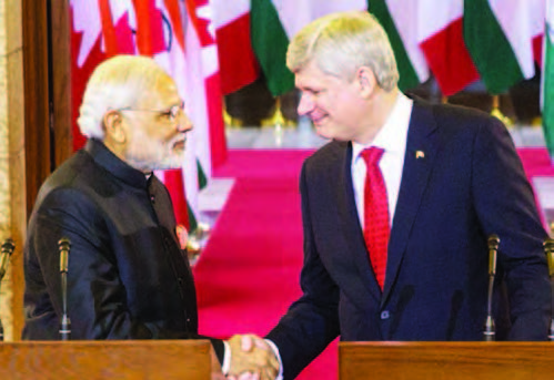 Prime Minister of Canada Stephen Harper and Narendra Modi, Prime Minister of India, shake hands following a joint press conference in Centre Block on Parliament Hill.